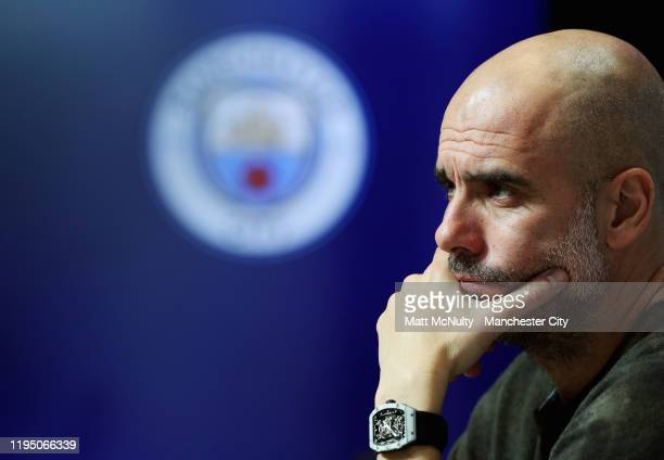 Pep Guardiola, manager of Manchester City speaks to the media during the press conference at Manchester City Football Academy on December 20, 2019 in...