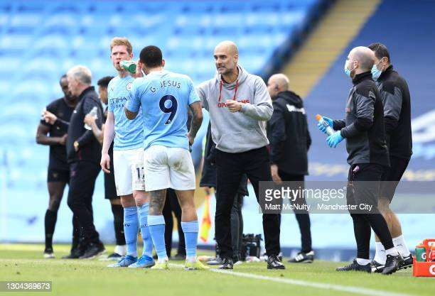 Pep Guardiola, Manager of Manchester City speaks with Gabriel Jesus of Manchester City during the Premier League match between Manchester City and...
