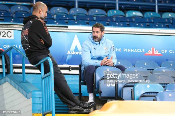 Pep Guardiola, manager of Manchester City speaks with goalkeeper Scott Carson in the stand during the Premier League match between Leeds United and...