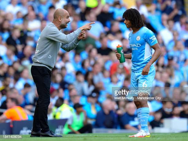 Pep Guardiola, manager of Manchester City speaks with Nathan Ake during the Premier League match between Manchester City and Southampton at Etihad...