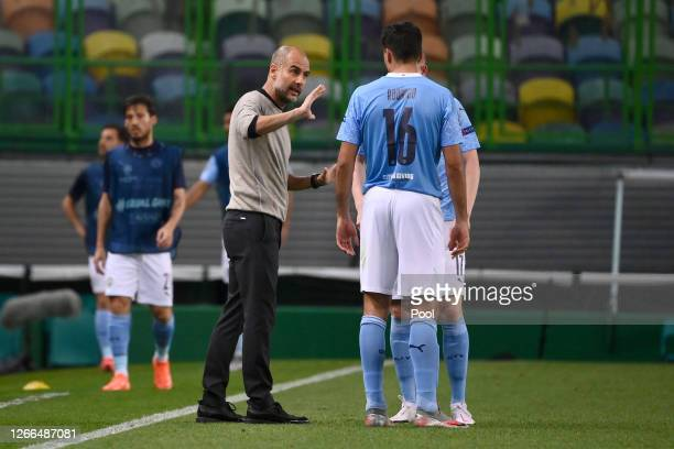 Pep Guardiola Manager of Manchester City speaks with Rodrigo of Manchester City during the UEFA Champions League Quarter Final match between...
