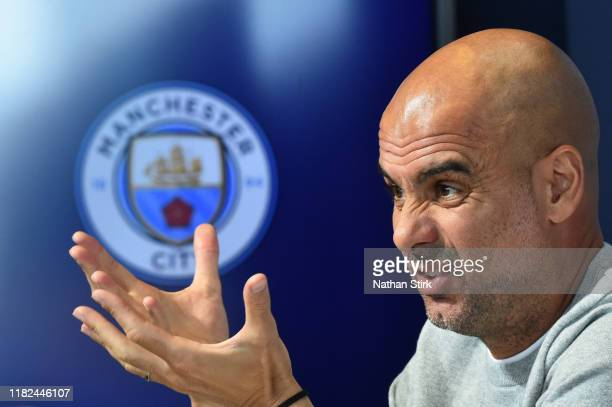 Pep Guardiola Manager of Manchester City speaks with the media during a Press Conference at The Academy Stadium on October 21 2019 in Manchester...
