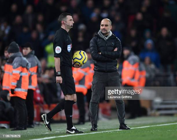 Pep Guardiola, Manager of Manchester City stares at referee Michael Oliver as he walks onto the pitch for the second halfduring the Premier League...