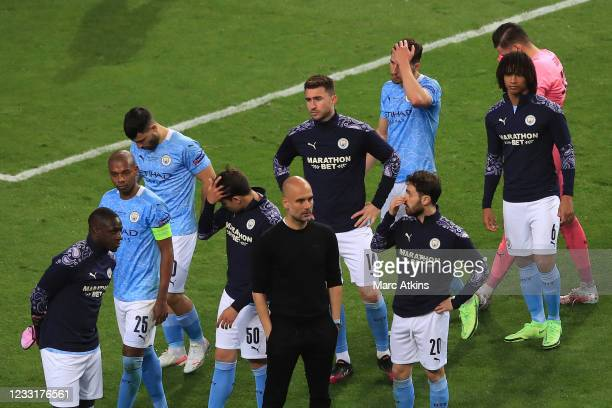 Pep Guardiola manager of Manchester City surrounded by his dejected players after during the UEFA Champions League Final between Manchester City and...