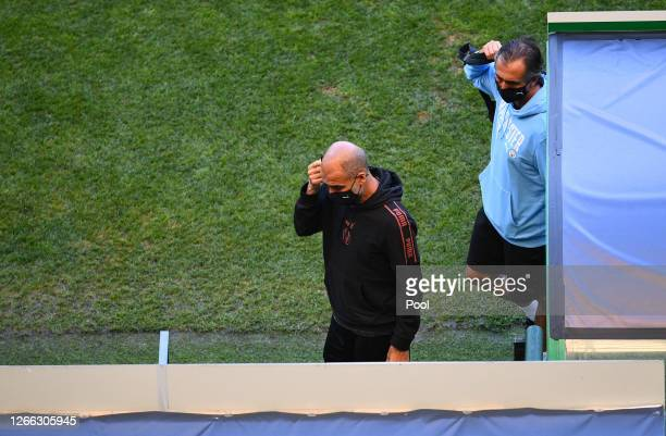 Pep Guardiola Manager of Manchester City takes a look around the stadium prior to the Olympique Lyonnais Training Session ahead of the UEFA Champions...
