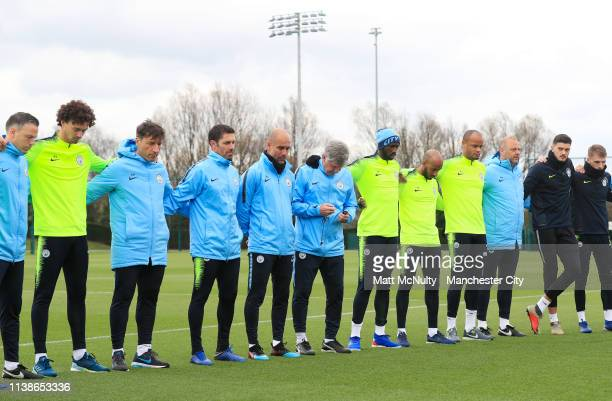 Pep Guardiola manager of Manchester City takes part in a minute's silence with his players in memory of Bernard Halford during the training session...