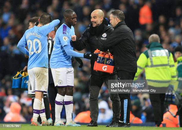 Pep Guardiola Manager of Manchester City talks to Benjamin Mendy and Bernardo Silva of Manchester City during the Premier League match between...