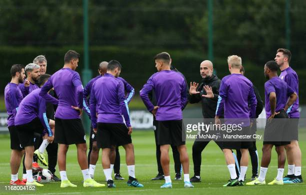 Pep Guardiola manager of Manchester City talks to his players during the training session at Manchester City Football Academy on August 14 2019 in...