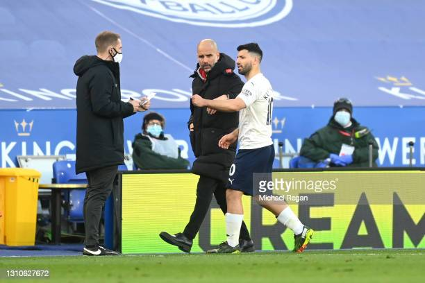 Pep Guardiola, Manager of Manchester City talks with Sergio Aguero of Manchester City after he is replaced during the Premier League match between...