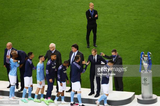 Pep Guardiola, Manager of Manchester City watches on as his team collect runners-up medals during the UEFA Champions League Final between Manchester...