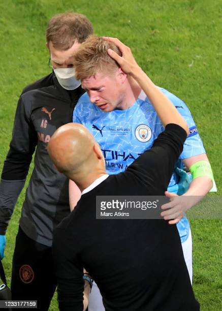 Pep Guardiola manager of Manchester City with Kevin De Bruyne as injury forces him out of the game during the UEFA Champions League Final between...