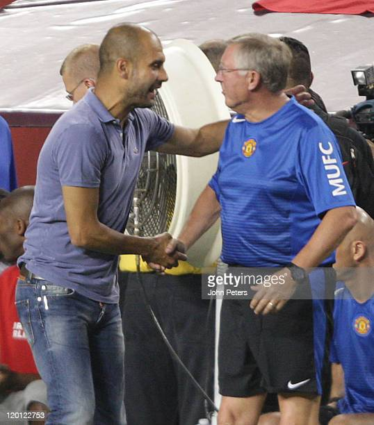 Pep Guardiola of Barcelona greets Sir Alex Ferguson of Manchester United after the pre-season friendly match between Manchester United and Barcelona...