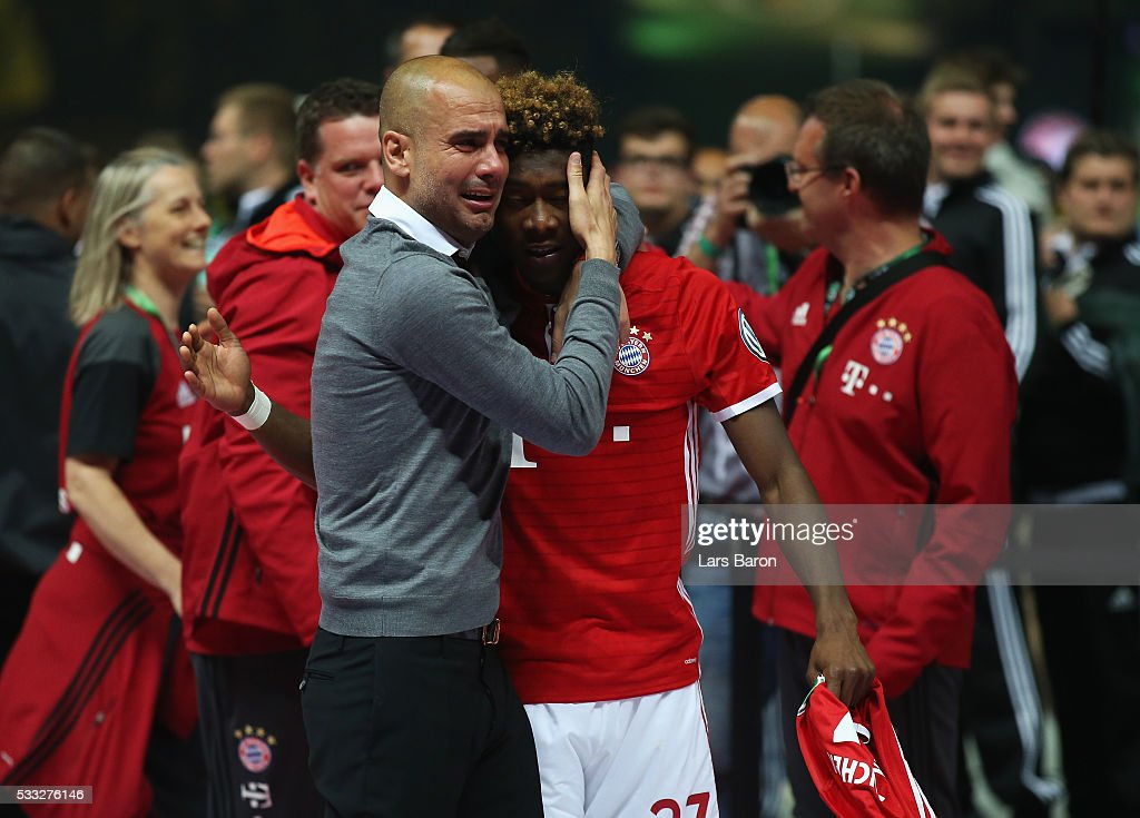 Pep Guardiola of Bayern Muenchen cries while hugging David Alaba after winning the DFB Cup Final in a penalty shootout against Borussia Dortmund at Olympiastadion on May 21, 2016 in Berlin, Germany.