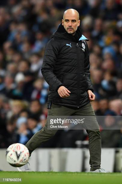 Pep Guardiola of Manchester City looks on during the FA Cup Third Round match between Manchester City and Port Vale at Etihad Stadium on January 04...