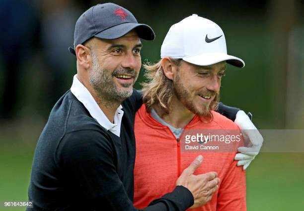 Pep Guardiola of Spain the Manchester City Football Club manager with his professional playing partner Tommy Fleetwood of England during the pro-am...