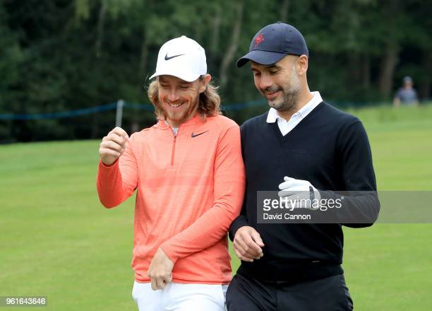Pep Guardiola of Spain the Manchester City Football Club manager with his professional playing partner Tommy Fleetwood of England during the proam...