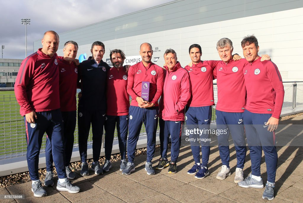 Pep Guardiola poses with his coaching staff with his Barclays Premier League Manager of the Month award for October at Manchester City Football Academy on November 16, 2017 in Manchester, England.
