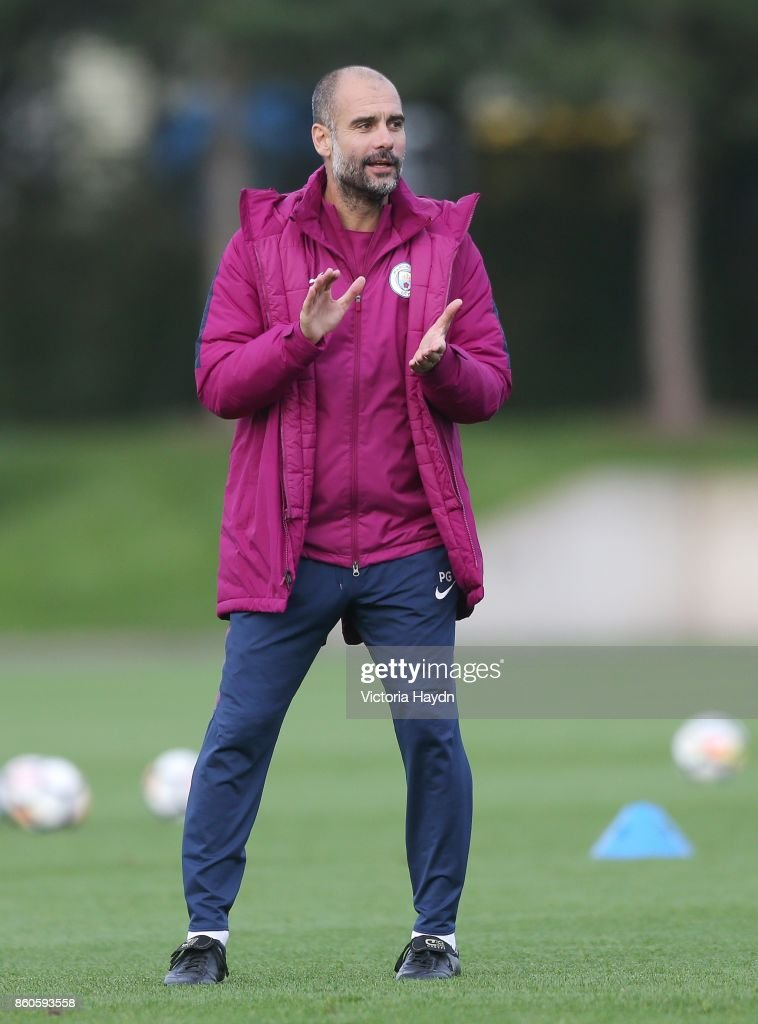 Pep Guardiola reacts during training at Manchester City Football Academy on October 12, 2017 in Manchester, England.