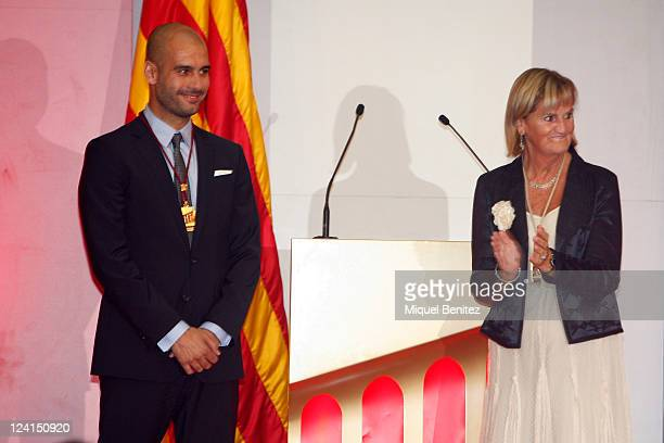 Pep Guardiola receives from Nuria de Gisbert president of de Parlament of Catalonia a gold medal of honour as a recognition for his career and his...