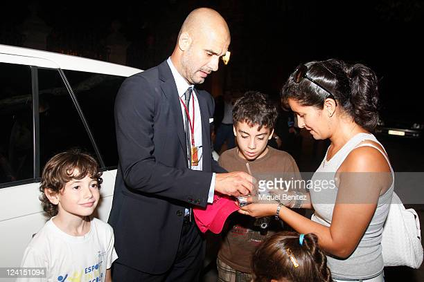 Pep Guardiola signs autographs after receiving a gold medal of honour as a recognition for his career and his contribution to the image of a cultured...