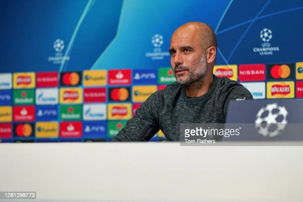 Pep Guardiola speaks during a press conference ahead of the UEFA Champions League Group C stage match between Manchester City and FC Porto at Etihad...