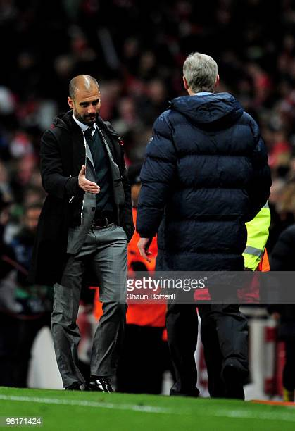 Pep Guardiola the Barcelona manager shakes hands with Arsene Wenger the Arsenal manager following their teams' 22 draw during the UEFA Champions...