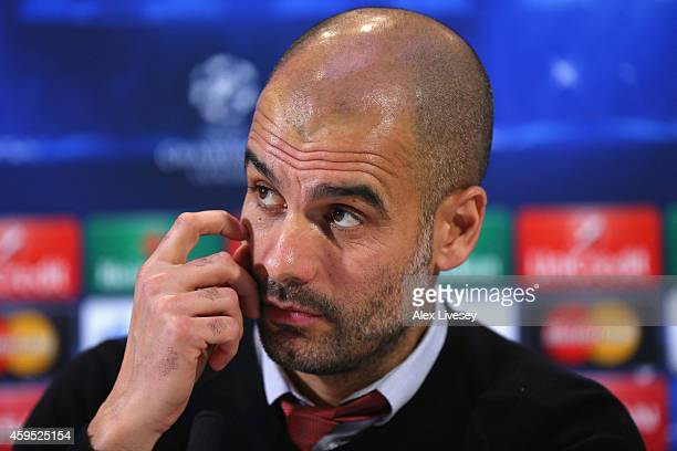 Pep Guardiola the coach of FC Bayern Muenchen faces the media during a press conference at the Lowry Hotel on November 24 2014 in Manchester United...