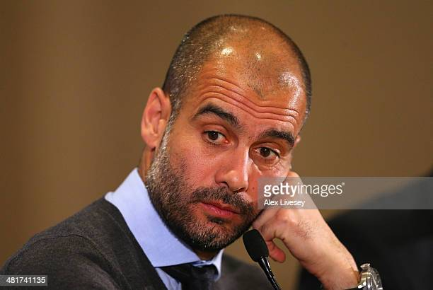 Pep Guardiola the coach of FC Bayern Muenchen faces the media during a press conference at the Marriott Hotel on March 31 2014 in Manchester England