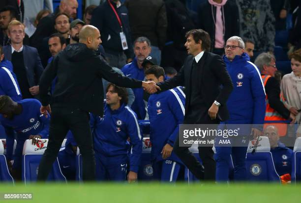 Pep Guardiola the head coach / manager of Manchester City and Antonio Conte manager / head coach of Chelsea after the Premier League match between...