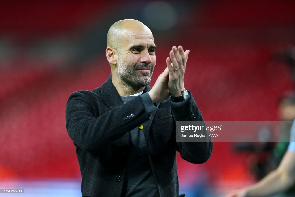 Pep Guardiola the head coach / manager of Manchester City applauds the fans during the Carabao Cup Final match between Arsenal and Manchester City at Wembley Stadium on February 25, 2018 in London, England.