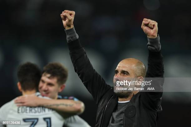 Pep Guardiola the head coach / manager of Manchester City celebrates at full time during the UEFA Champions League group F match between SSC Napoli...