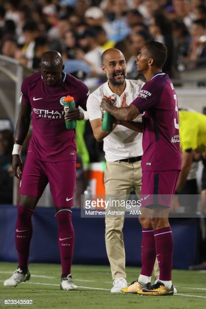 Pep Guardiola the head coach / manager of Manchester City gives instructions to Danilo during the International Champions Cup 2017 match between...