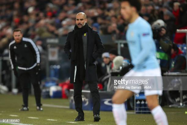 Pep Guardiola the head coach / manager of Manchester City looks on during the UEFA Champions League Round of 16 First Leg match between FC Basel and...