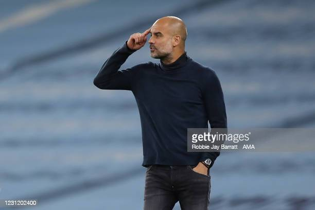 Pep Guardiola the head coach / manager of Manchester City points to his head during the UEFA Champions League Group C stage match between Manchester...