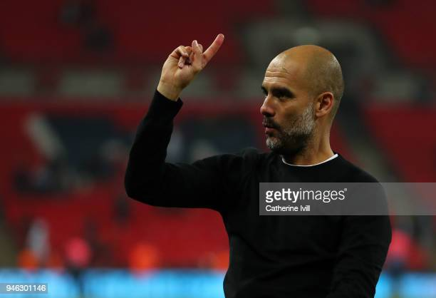 Pep Guardiola the head coach / manager of Manchester City raises his finger to indicate one more game after the Premier League match between...