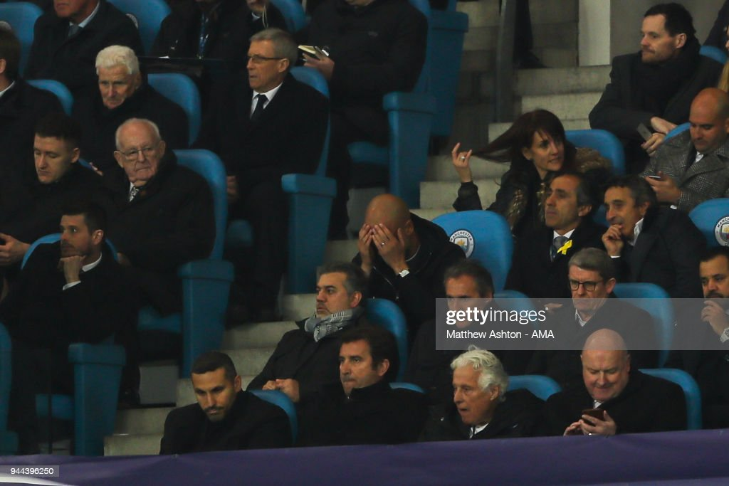 Pep Guardiola the head coach / manager of Manchester City reacts after the second goal whilst sat in the stands after being sent off at half time during the UEFA Champions League Quarter Final Second Leg match at Etihad Stadium on April 10, 2018 in Manchester, England.