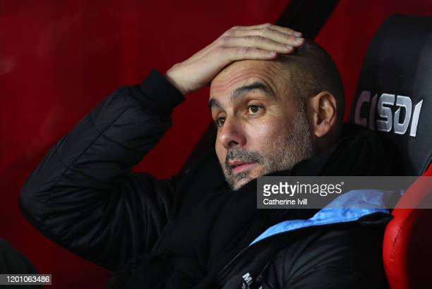 Pep Guardiola the head coach / manager of Manchester City rubs his head before the Premier League match between Sheffield United and Manchester City...