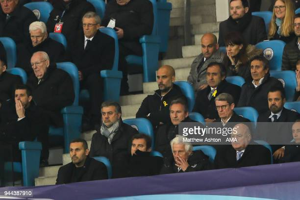 Pep Guardiola the head coach / manager of Manchester City sits in the stand after being sent off at half time during the UEFA Champions League...