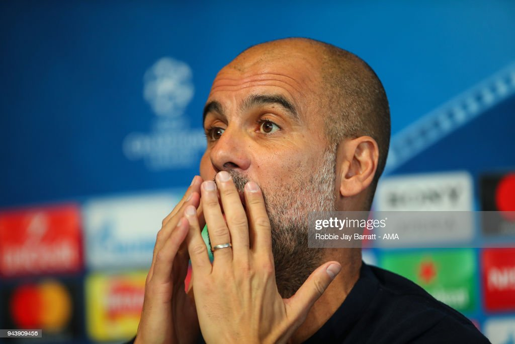 Pep Guardiola the head coach / manager of Manchester City talks to the press during a Press Conference and Training Session at Manchester City Football Academy on April 9, 2018 in Manchester, England.