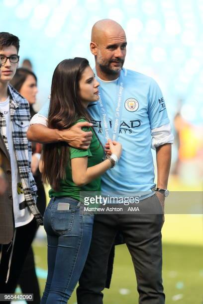 Pep Guardiola the head coach / manager of Manchester City with his daughter Valentina Guardiolal during the championship celebrations after the...