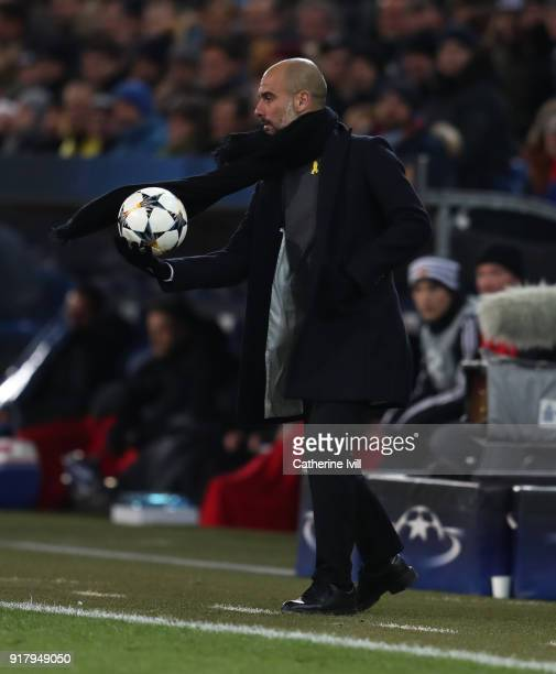 Pep Guardiola the head coach / manager of Manchester City with the ball during the UEFA Champions League Round of 16 First Leg match between FC Basel...