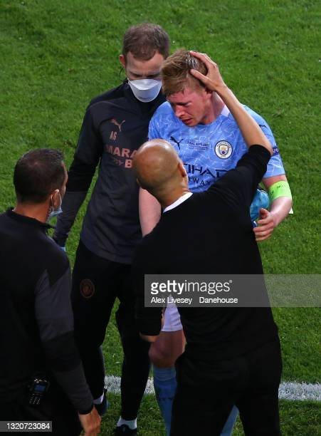Pep Guardiola the manager of Manchester City checks on Kevin De Bruyne of Manchester City as he is assisted off the pitch and substituted after an...