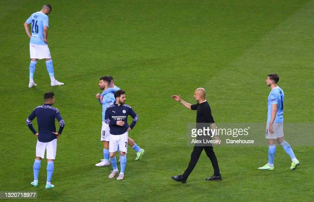 Pep Guardiola the manager of Manchester City consoles his players after defeat in the UEFA Champions League Final between Manchester City and Chelsea...