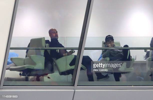 Pep Guardiola the manager of the Manchester City first team watches from the stands during the FA Youth Cup Final between Manchester City and...