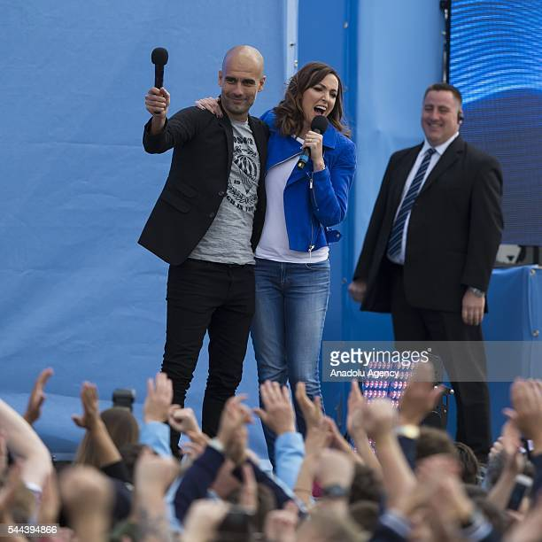 Pep Guardiola waves his hand after interviewed on stage by television presenter Sally Nugent during the supporters event at the City Football Academy...