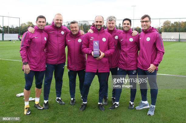 Pep Guardiola with his coaching staff poses with the Barclays Manager of the Month Award for September 2017 at the Manchester City Football Academy...
