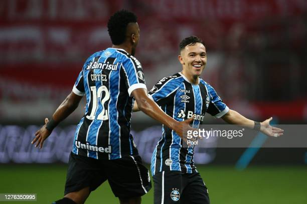 Pepê of Gremio celebrates after scoring the the first goal of his team with teammates Bruno Cortez of Gremio during a group E match of Copa CONMEBOL...