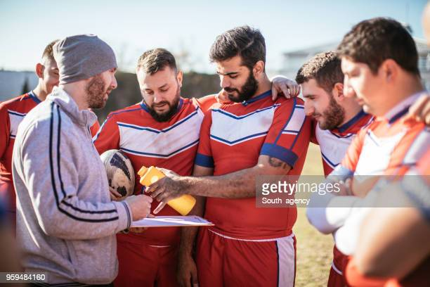 pep talk during time out - rugby union stock pictures, royalty-free photos & images