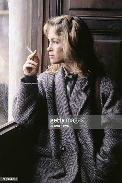 Pepa Flores Marisol actress Smoking a cigarette looking through a window
