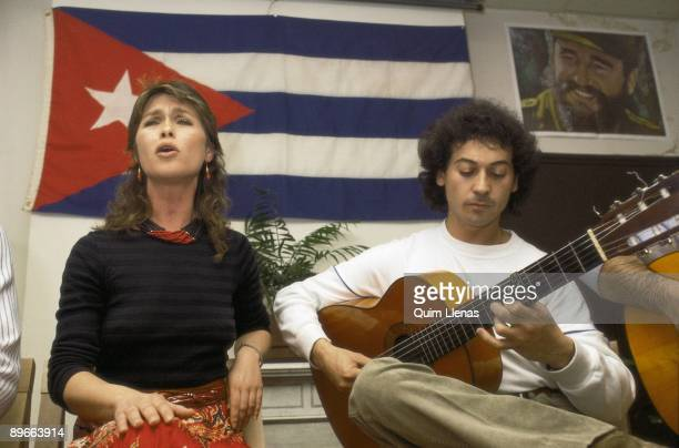 Pepa Flores, Marisol, in a pro-Cuba act The actress singing with a guitar player